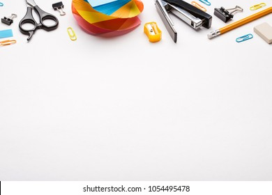 school supplies on white background. office supplies top frame. copy space