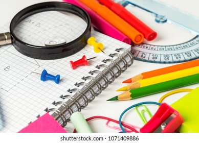 School Supplies on White Background. Selective Focus. Concept of Education.