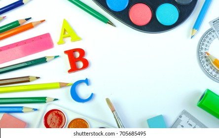 School supplies on a white background. Beginning of the school year. Copy spaces.