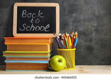 School supplies on white wooden background