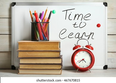 School supplies on wooden background. Time to learn
