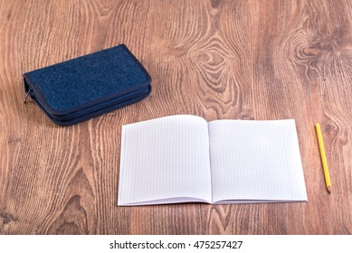 School supplies on the wooden background