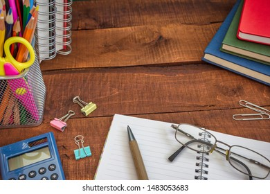 School supplies on wooden table. Back to school background with copy space.