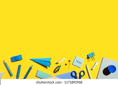 School supplies on yellow background. Back to school creative illustration, template.