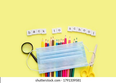 School supplies on yellow background. Back to school concept. New school year 2020. Flat lay. Copy space.