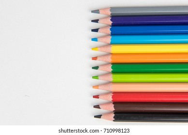 School supplies with paints and pencils on a white background