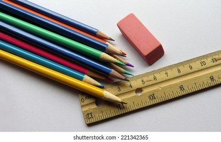School supplies of pencil crayons, pink eraser and ruler