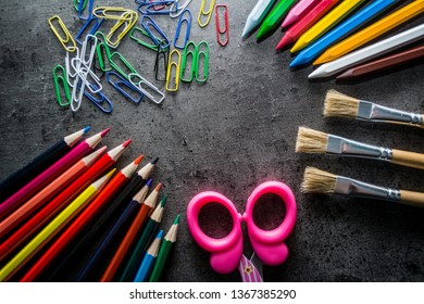 School supplies. Pencils, pens, scissors. Place for text.