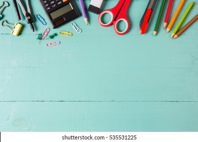 school supplies, stationery accessories on wood background. Flat lay, top view