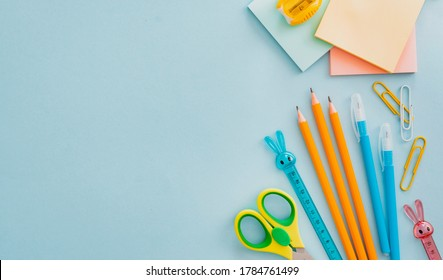 School supplies stationery on a blue background, back to school concept with copy space for text, flat lay, top view, mockup, free space