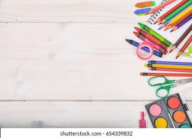 School supplies, stationery on white background - space for caption, top view