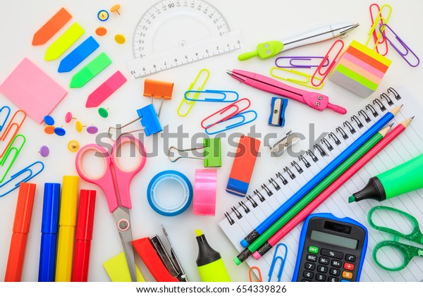 School supplies and stationery on white background, top view