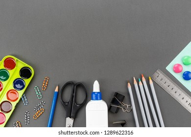 school supplies for study on a gray background. space for text