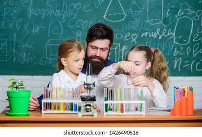 School teacher of biology. Man bearded teacher work with microscope and test tubes in biology classroom. How to interest children study. Explaining biology to children. Fascinating biology lesson.
