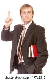 School teacher with books lifts finger upwards, isolated on white background.