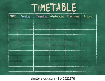 school timetable or class schedule on green classroom chalkboard