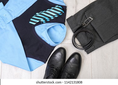 School uniform for boy on laminate, top view