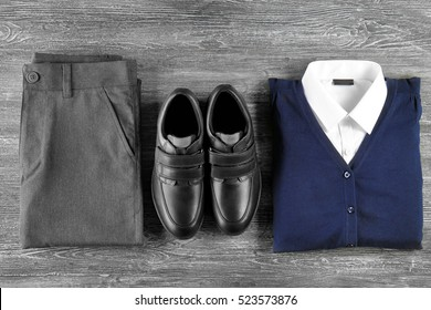 School uniform on wooden background