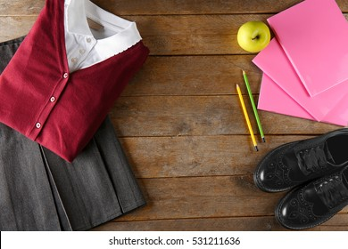 School uniform on wooden background