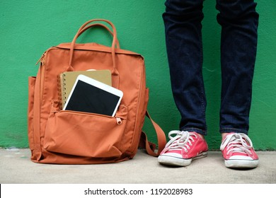 School, university teenager and digital tablet in school bag, backpack, Student and digital tablet gadget standing in college, campus, university, online learning education concept