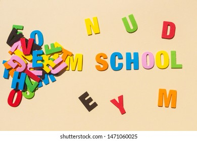 School written with colored letters and heap of letters