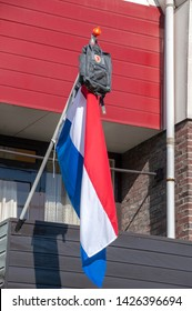Schoolbag On A Flag At Amstelveen The Netherlands 2019. A Dutch Tradition For Passing School Exams