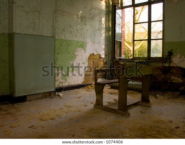 schoolbench left behind in a deserted building