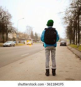 schoolboy alone in the street