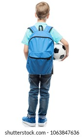 schoolboy with backpack and a football ball view from behind on a white background