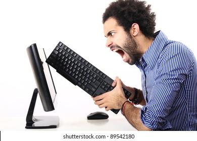 schoolboy behind his computer