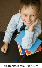 Schoolboy with books. Smiles.
