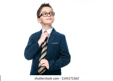 schoolboy in businessman suit tying necktie isolated on white