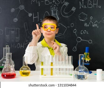 schoolboy in chemistry lab got an idea practising experiments