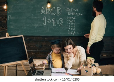 Schoolboy in class. Schoolboy learn drawing. Little schoolboy have lesson with teacher and tutor. Schoolboy develop art skills. Hand in hand we learn.