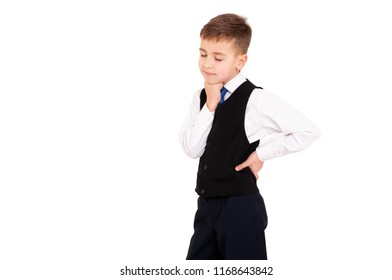 Schoolboy with closed eyes in white shirt and black waistcoat on isolated white background holding his hand near the chin.