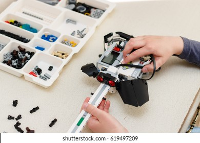 The schoolboy constructs the roboguitar. The Lego robot. Lessons of robotics. Stem education. Minsk, Belarus - April 4, 2017.