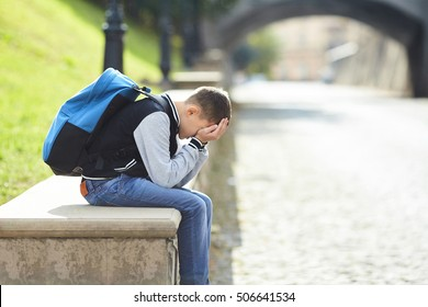schoolboy crying on the street, negative emotion