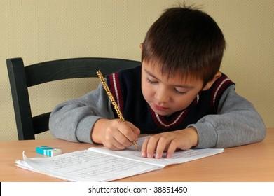 schoolboy doing his homework