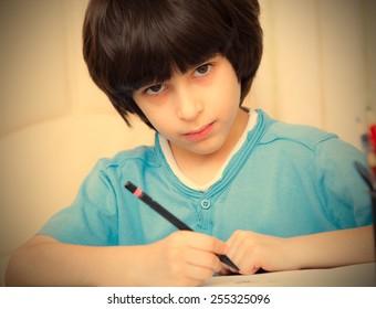 schoolboy doing homework, portrait. instagram image retro style
