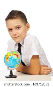 Schoolboy with a globe isolated in studio