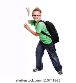 Schoolboy holding the blank board