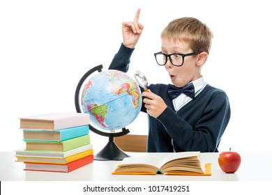 schoolboy with a magnifying glass opened new horizons staring into the globe