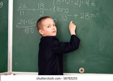 schoolboy on the lesson in a classroom