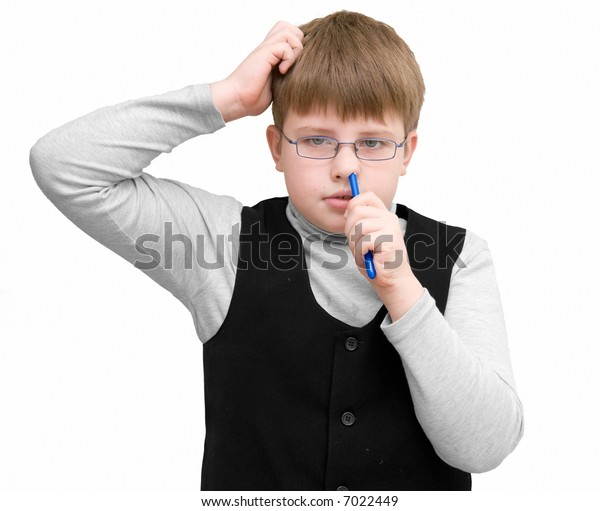 The schoolboy picks one's nose on a white background