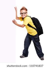 Schoolboy pushing big blank board