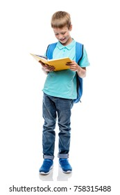 schoolboy reading a book on a white background in the studio, portrait isolated