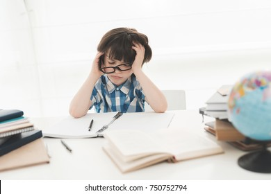 The schoolboy is tired of doing homework. He wants to walk. He was given a lot of homework.