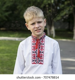 schoolboy in ukranian embrodery traditional shirt