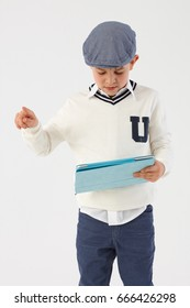 Schoolboy using tablet computer.