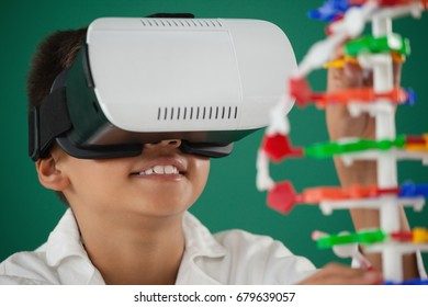 Schoolboy using virtual reality headset in laboratory at school